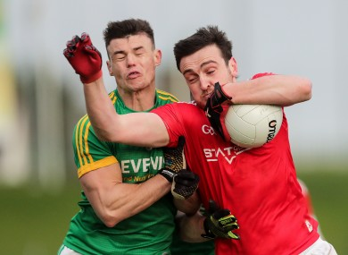 Meath's Gavin McCoy in action against Louth's Tommy Durnin.