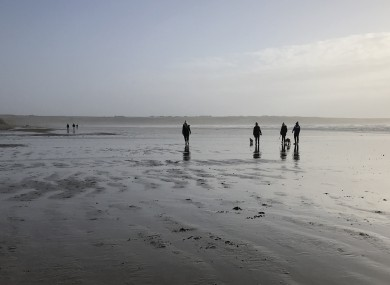 St Stephen's Day walkers on Tramore Beach, Co Waterford.