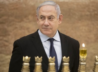 Israeli Prime Minister Benjamin Netanyahu lighting a Hanukkah candle at the Western Wall.
