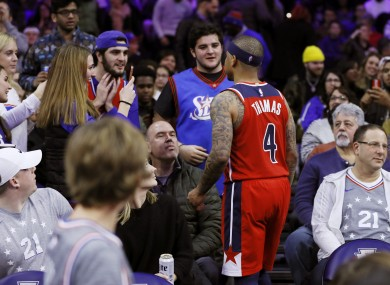 Isaiah Thomas confronts a fan during the Washington Wizards' 125-108 defeat to the Philadelphia 76ers.