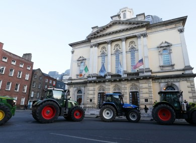 Lines of tractors pass the Davenport hotel during the farmers protest in Dublin