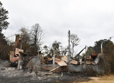 The remains of a house damaged by a  bushfire around 160 kilometres from Sydney.