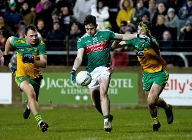 James Durcan in action for Mayo against Donegal's Conor O'Donnell and Caolan Ward.