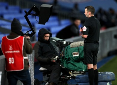 Michael Oliver looks at a pitchside monitor during Crystal Palace's FA Cup third-round clash with Derby.