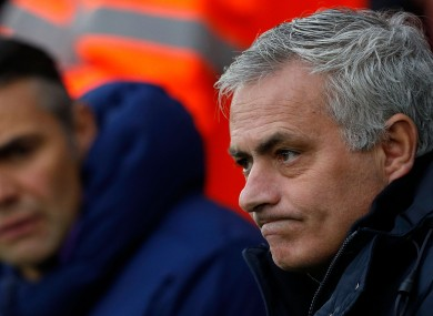 A frustrated Jose Mourinho watches on.
