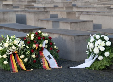 File photo of wreaths laid before a commemoration ceremony today at the Memorial to the Murdered Jews in Berlin