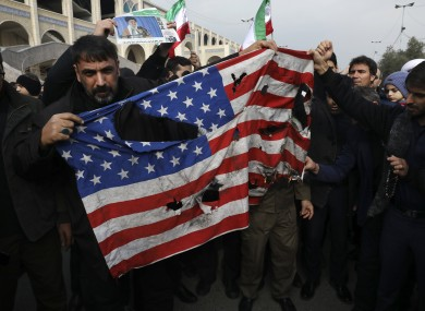Protesters burn a US flag during a demonstration over the airstrike in Iraq that killed Iranian Revolutionary Guard General Qassem Soleimani.