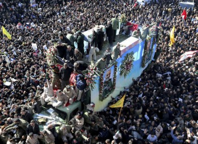 The coffin of Qassem Soleimani carried through the city of Kerman in Iran.