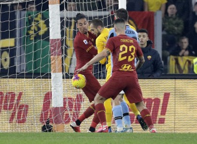 A late mix-up in the Rome derby allowed  Francesco Acerbi score for Lazio.