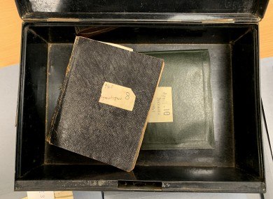 Seán Lester's diaries, inside the metal case he buried them in.