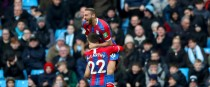 Crystal Palace's Cenk Tosun celebrates scoring his side's first goal with James McCarthy.