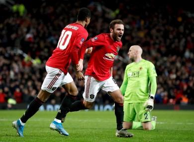 Manchester United's Juan Mata (right) celebrates scoring.