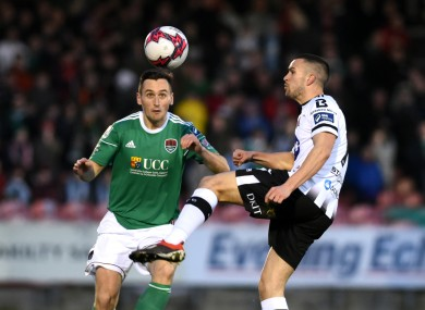 Cork City defender Conor McCarthy heads the ball clear despite the attention of Dundalk winger Michael Duffy.