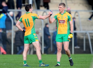 Michael Farragher and Kieran Fitzgerald celebrate after their victory over Nemo Rangers.