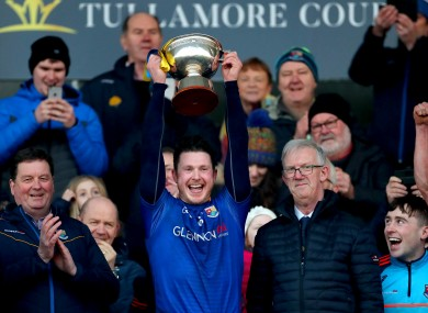 Michael Quinn lifts the O'Byrne Cup.