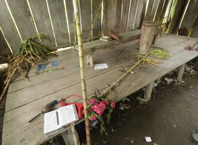 Bibles, flowers, a drum and a microphone are seen inside the improvised temple where a pregnant woman, five of her children and a neighbour were killed in a religious ritual.