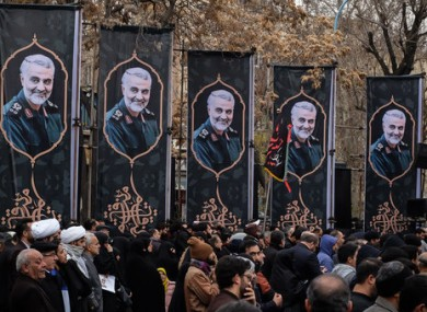 Iranians take part in a rally to protest the killing in Tehran.