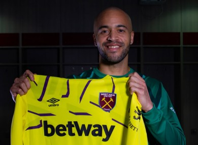 The Wicklow stopper holding up his Hammers shirt.