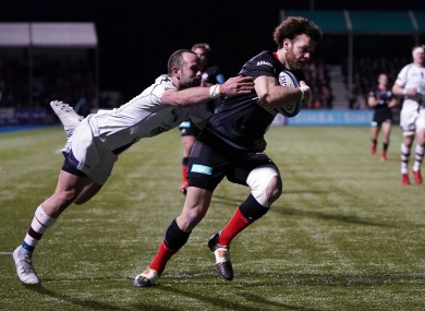 Saracens' Duncan Taylor goes over for a try at Allianz Park.