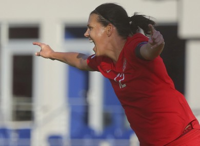 Christine Sinclair celebrates after scoring against St. Kitts and Nevis.