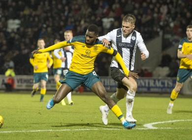 St Mirren defender Sean McLoughlin tangling with Odsonne Edouard of Celtic.