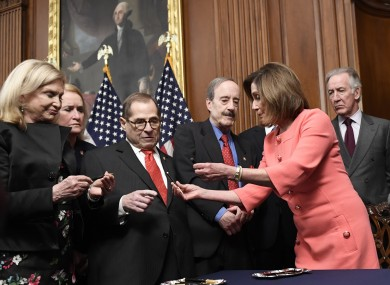 House Speaker Nancy Pelosi gives pens out after signing the resolution to transmit articles of impeachment against President Donald Trump to the Senate.