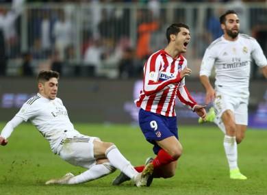 Federico Valverde hacks at Alvaro Morata.