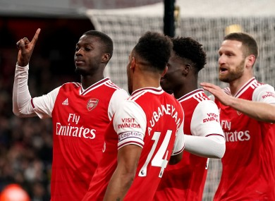 Arsenal's Nicolas Pepe (left) celebrates scoring his side's second goal of the game with team-mates.