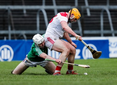 Westmeath's Conor Shaw and Cork's Declan Dalton battle for possession.