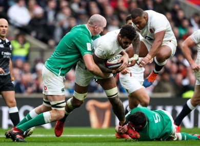 Courtney Lawes charges at Devin Toner.