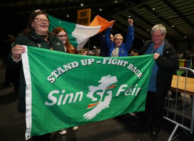 Sinn Fein supporters celebrate as ballot papers are counted at the RDS.
