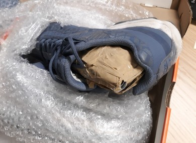 Concealed package of cocaine inside a pair of runners.