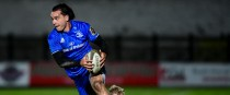 Leinster's James Lowe is tackled by Aled Davies of Ospreys.