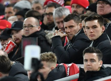 James Milner pictured watch Liverpool's FA Cup win last night.