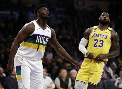 Zion Williamson next to Los Angeles Lakers' LeBron James .