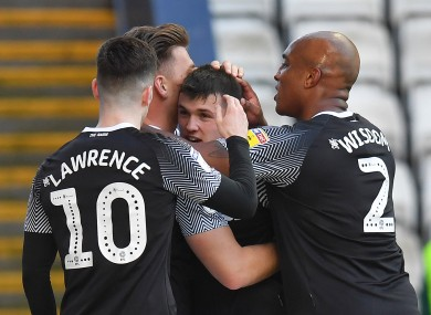 Derby County's Jason Knight is congratulated by teammates after his goal.