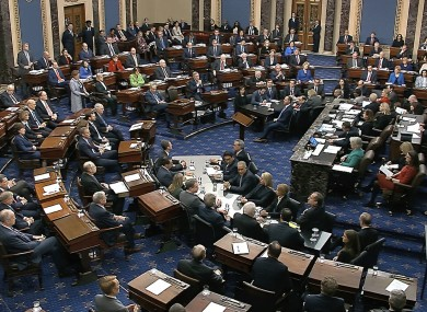 Senators vote on the first article of impeachment during the impeachment trial against President Donald Trump in the Senate.