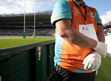 Security at this morning's match between the Blues and Lions in Auckland wearing protective gloves.