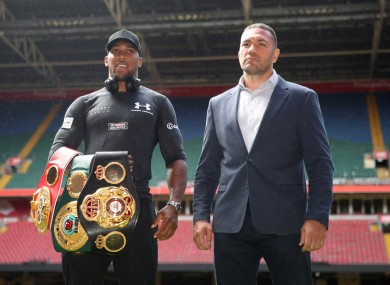 Joshua and Pulev pose for promo pictures ahead of their subsequently cancelled fight at Cardiff's Principality Stadium.