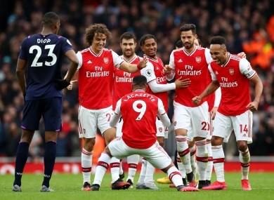 Arsenal celebrate their late win today.