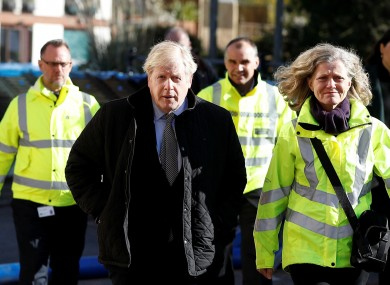 Johnson with police and emergency workers in England today.