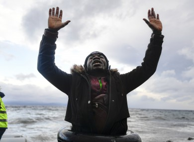 A man reacts as he arrives with other migrants on the Greek island of Lesbos on Saturday.