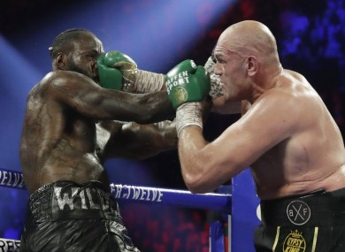 Tyson Fury, of England, lands a right to Deontay Wilder (file pic).