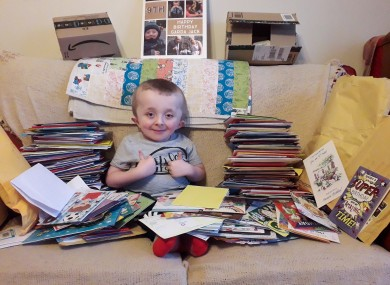 Jack is pictured with some of his cards and parcels.