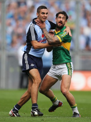 James McCarthy and Paul Galvin tussle during the game.
