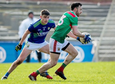 Sean O'Shea in action for Kerry against Mayo's Kevin McLoughlin.