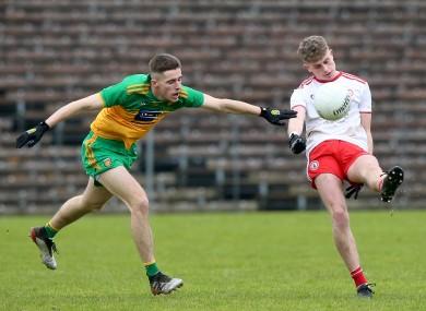 Tyrone's Tiarnan Quinn battles with Donegal's Matthew Duffy.
