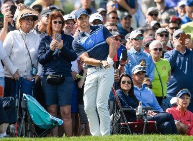 Rory McIlroy watches his chip shot onto the 6th green during second round golf action of the Arnold Palmer Invitational.