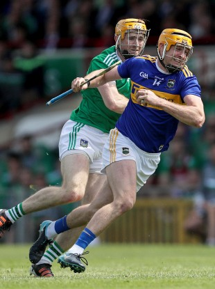 Tipperary's Seamus Callanan and Limerick's Richie English in action in last year's Munster final.
