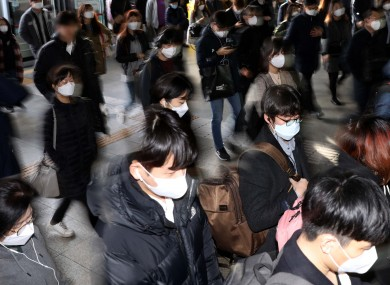 People wearing masks are seen at Sindorim Station in Seoul, South Korea.
